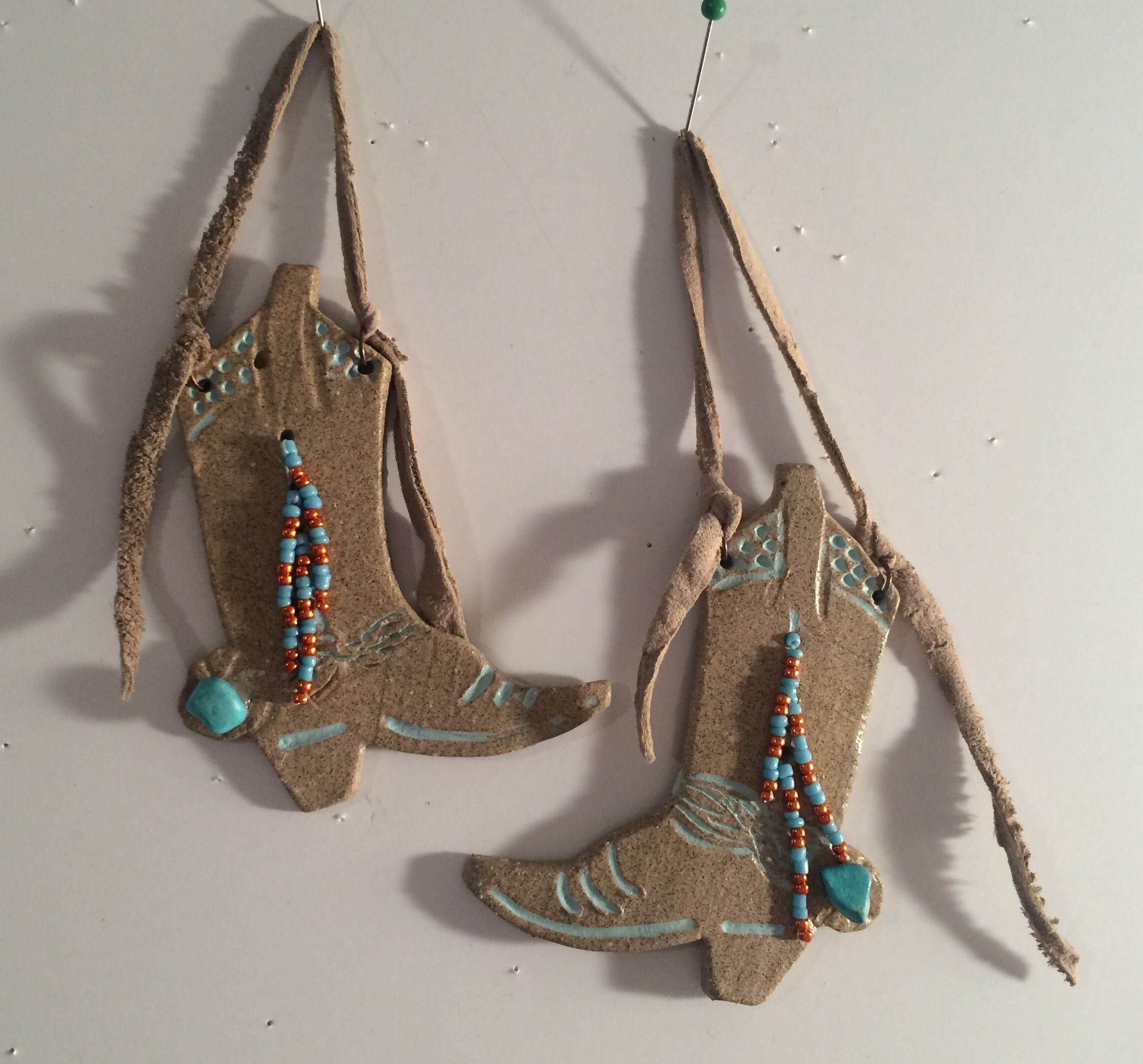 OOAK Stoneware Cowboy boots Focal. Trimmed wth leather, glass beads and gunine…