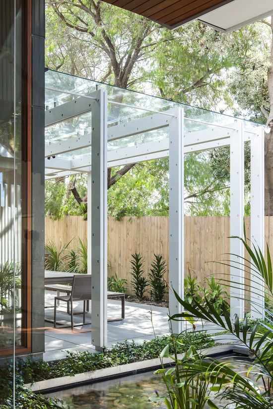 Modern pergola with glass top and stainless steel beams