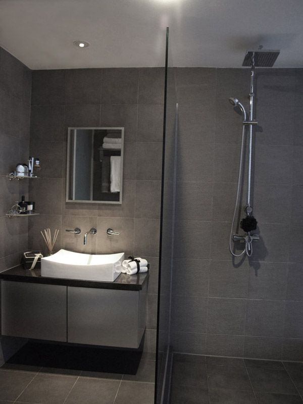en suite bathroom. Spotlight over sink and mirror.