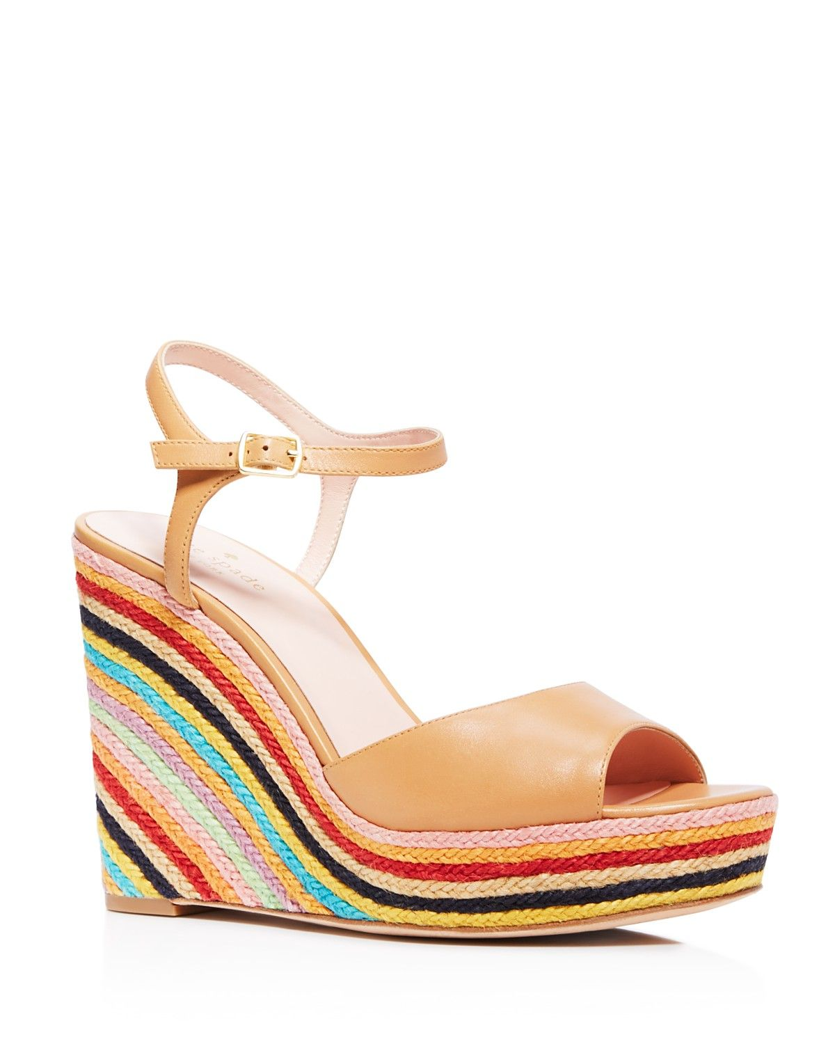 b8dd80de3 Walk on sunshine with kate spade new york's Dallie rainbow-striped jute wedge  sandals in a so-now '70s silhouette designed exclusively for Bloomingdale's.