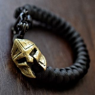 Description: Spartan Bead in Solid Brass Snake Knot Black Mini Snap Shackle 550 Paracord - Will Not Rot or Mildew Dries Quickly Comes in a Luxe Box with a Certification of Authenticity Please specify which color cord you would prefer in the comment section at checkout. For up to date wait times, please email theoriginalparadime@gmail.com