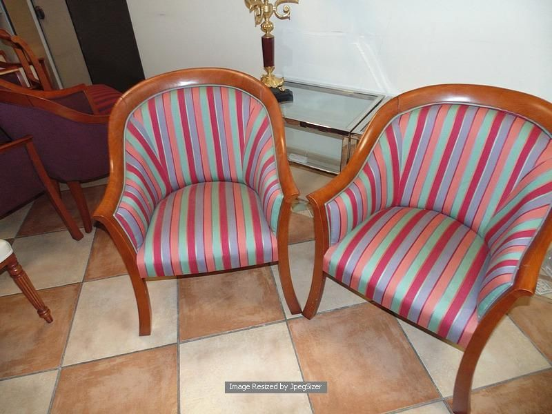 Lot 1192 - A pair of polished mahogany framed upholstered club chairs multistripe satin type fabric