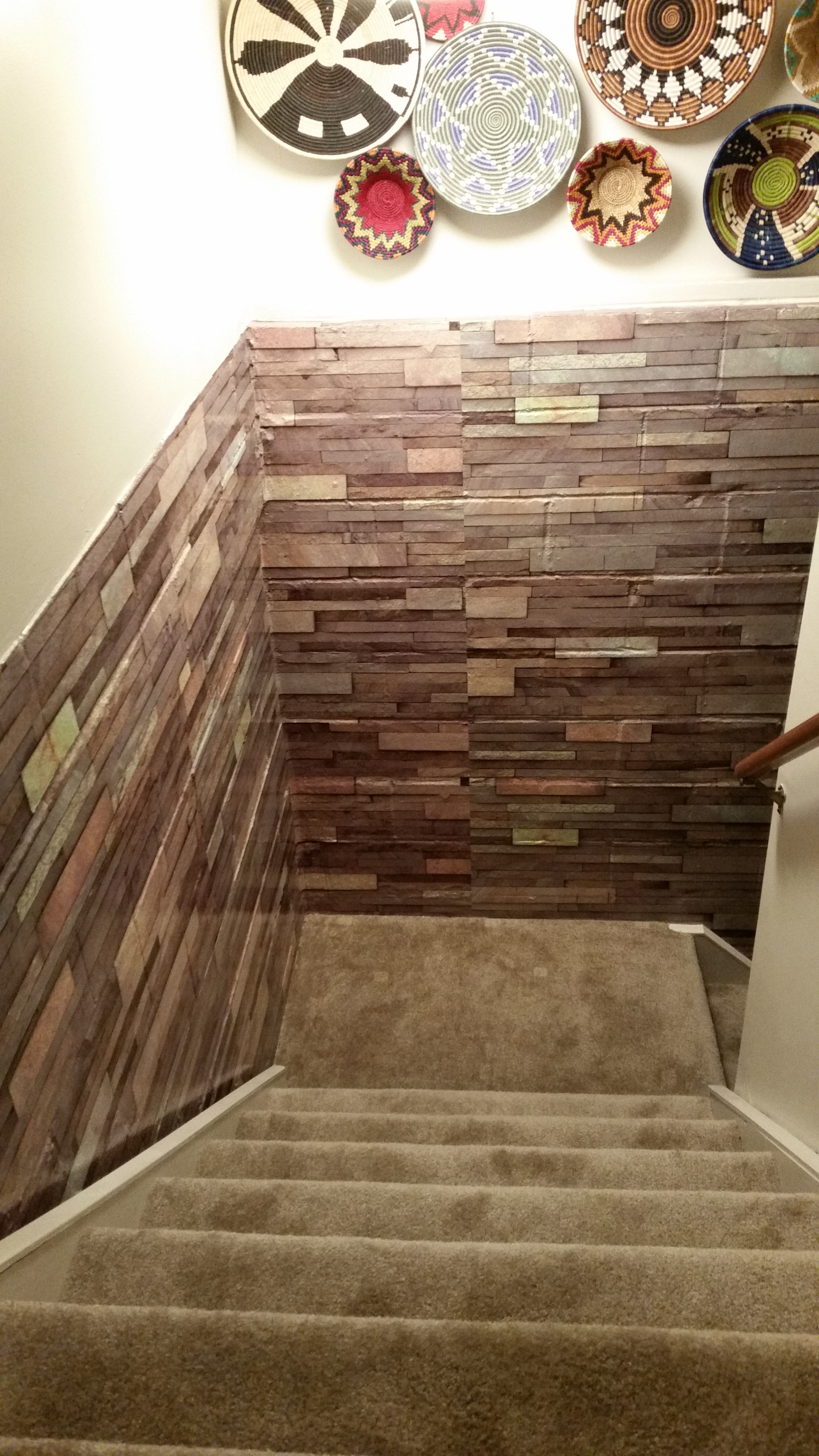 """Have an ugly concrete wall you hate..but you don't want to spend the money to have a total room remodel? We did too. We did a """"wall wrap"""". We found an image of stacked stone. We printed, laminated & applied the panels over our concrete wall. Now our laundry room is not so creepy and we think the wrap looks pretty real!"""