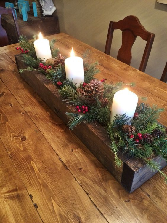 Elegant Christmas Table Centerpieces To Your Holiday Decor Charming wooden box centerpiece filler with greenery, candles and pinecones.Charming wooden box centerpiece filler with greenery, candles and pinecones.