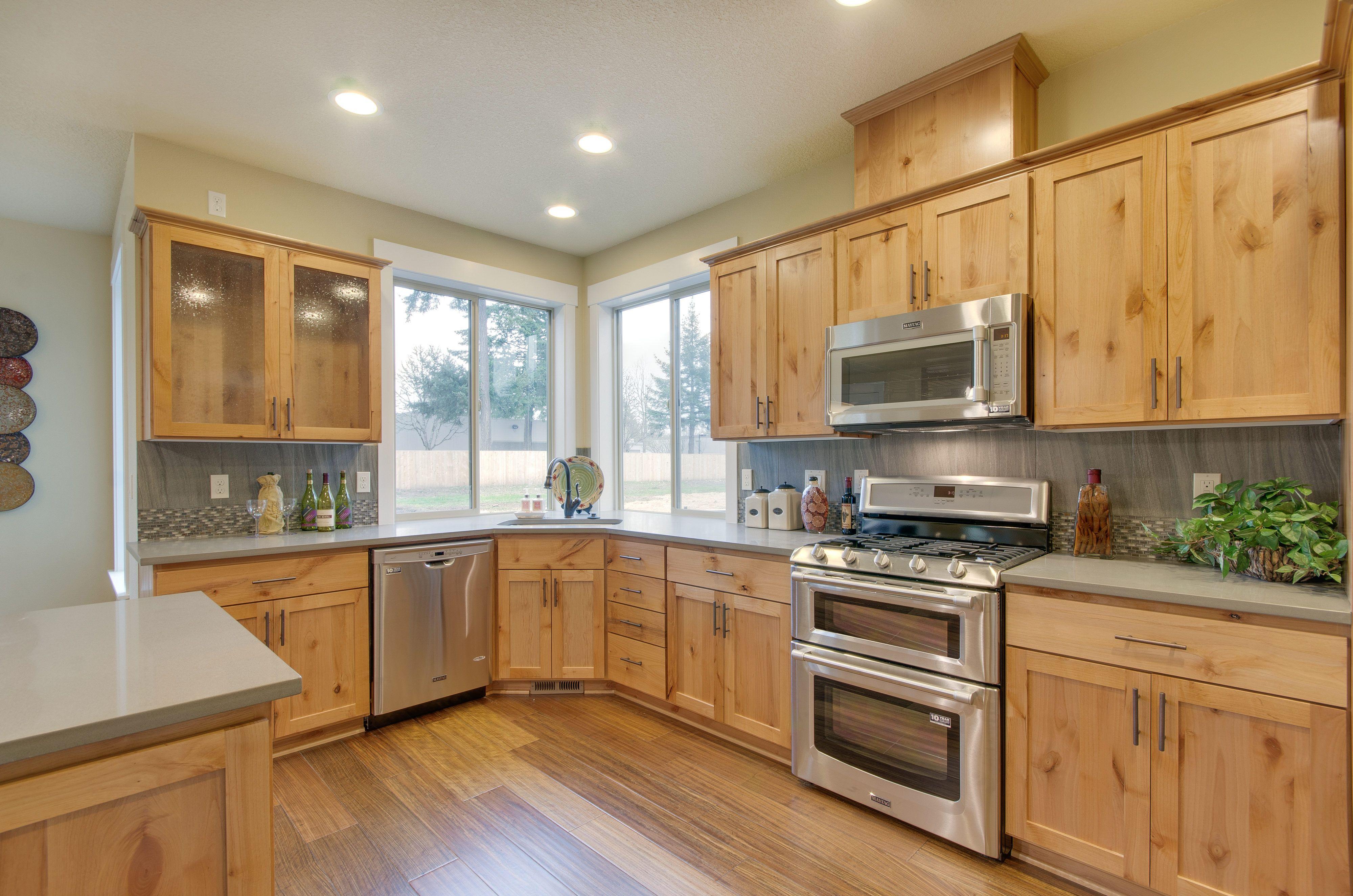 Kitchen With Knotty Alder Cabinetry Slab Quartz