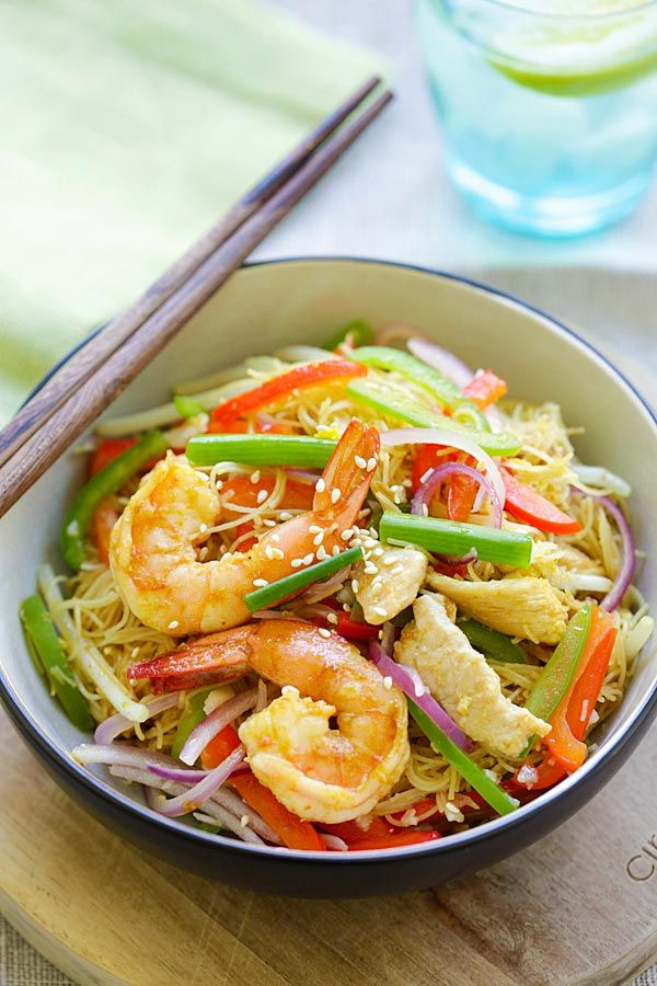Singapore Noodles - curry-flavored fried rice noodles with chicken and shrimp. The BEST Singapore noodle recipe to try at home!   rasamalaysia.com