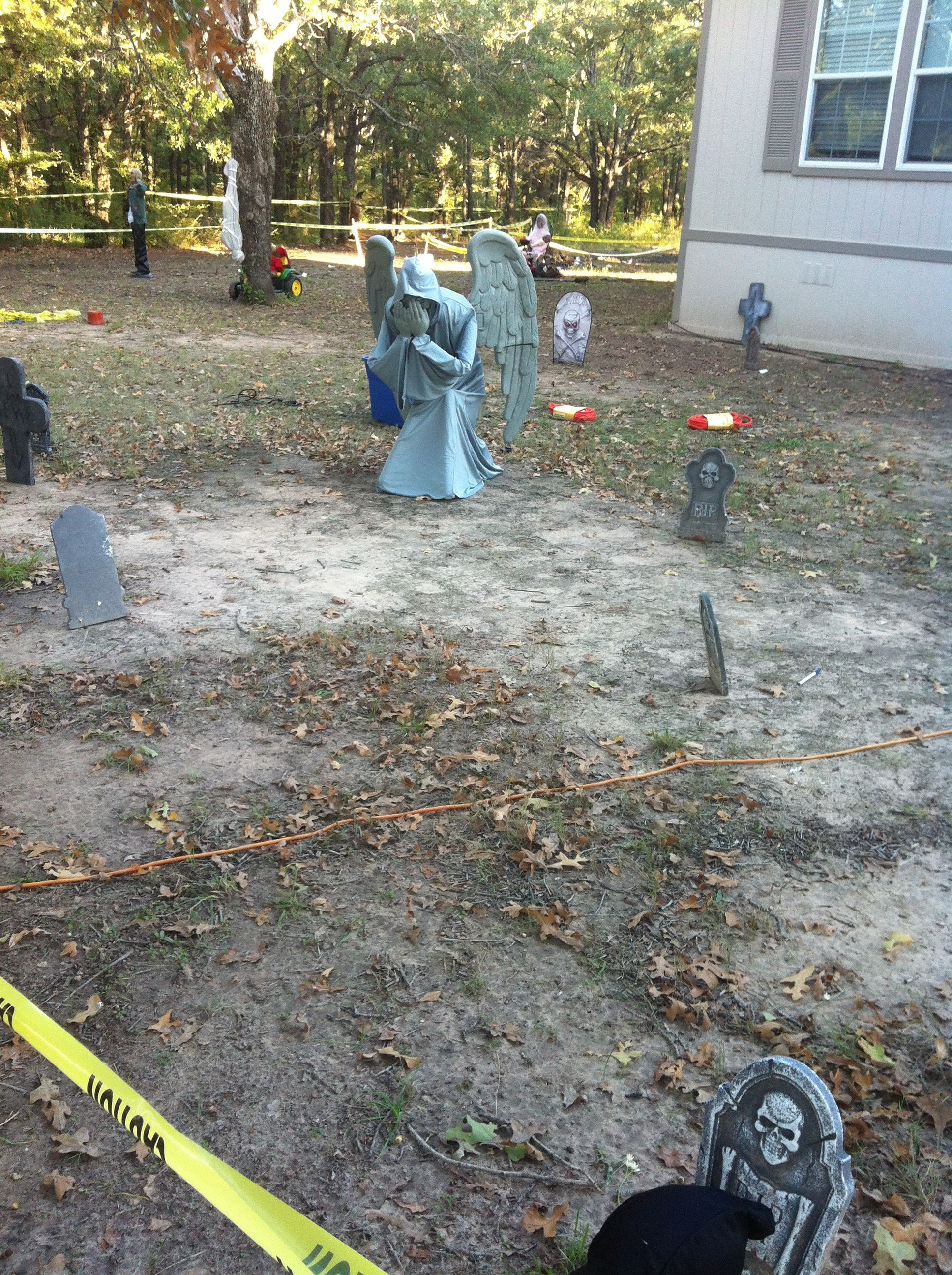 The cemetery angel from Spirit Halloween is one of my husband's ...