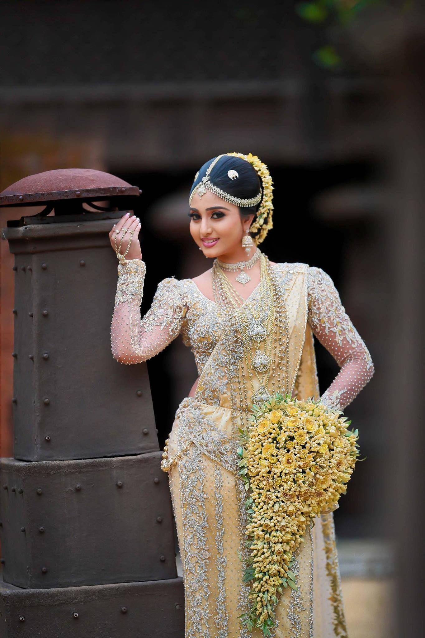Sri lankan bride dressed by nishi hadunnettige sri for Sri lankan wedding dress