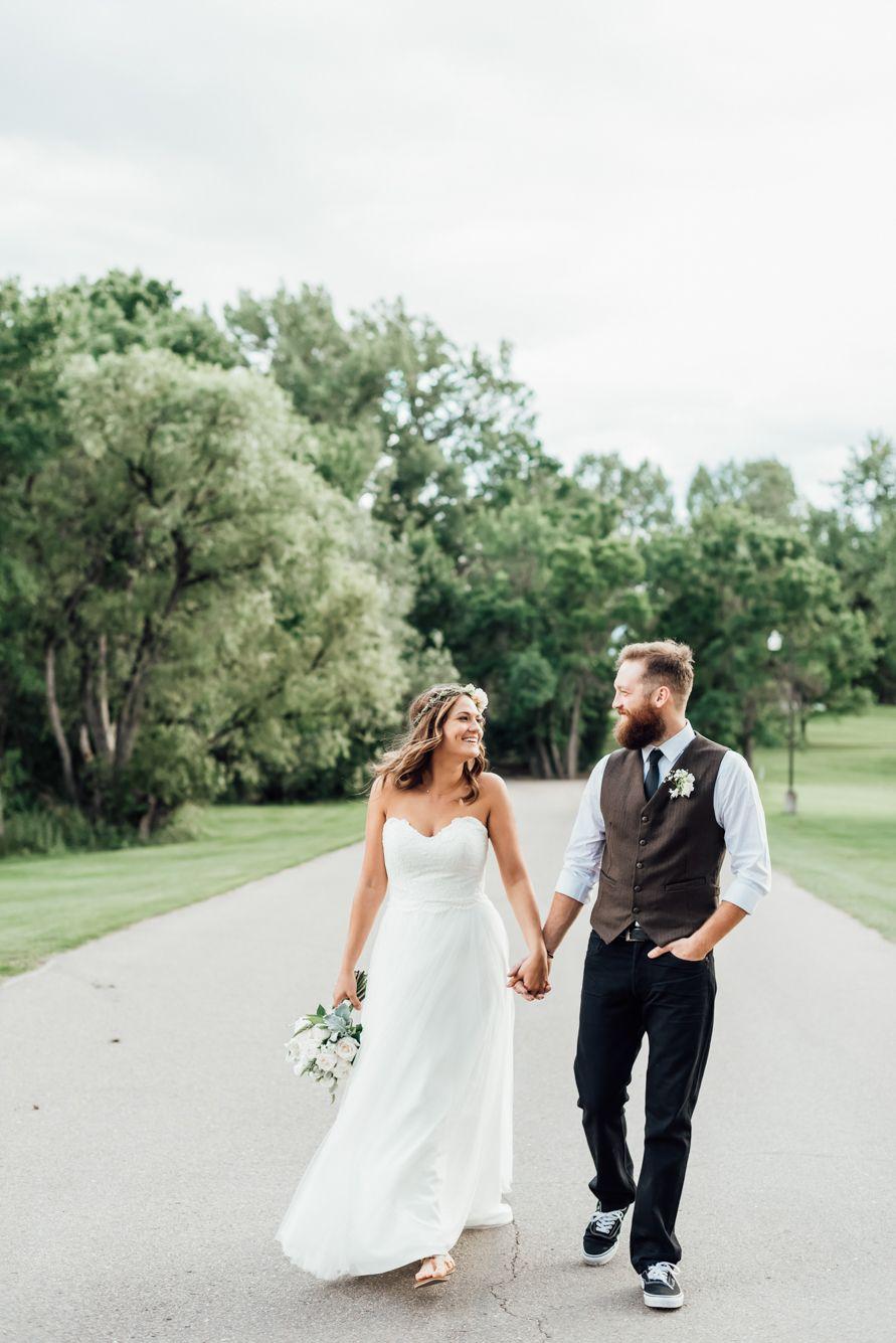 Bride and groom strolling along after the ceremony. Wedding flower crowns.  Vans. Wedding Raccoon Creek in Littleton 391ee44f0