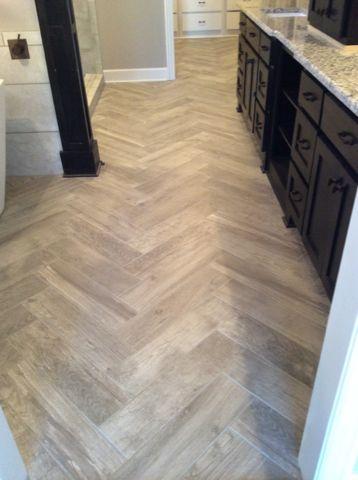 Del Conca Lumber Grey 6x24 Tile Laid In A Herringbone Pattern