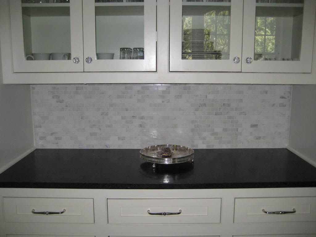Glass Front Cabinets, Glass Knobs, Marble Mini Tile Backsplash, Black  Countertops