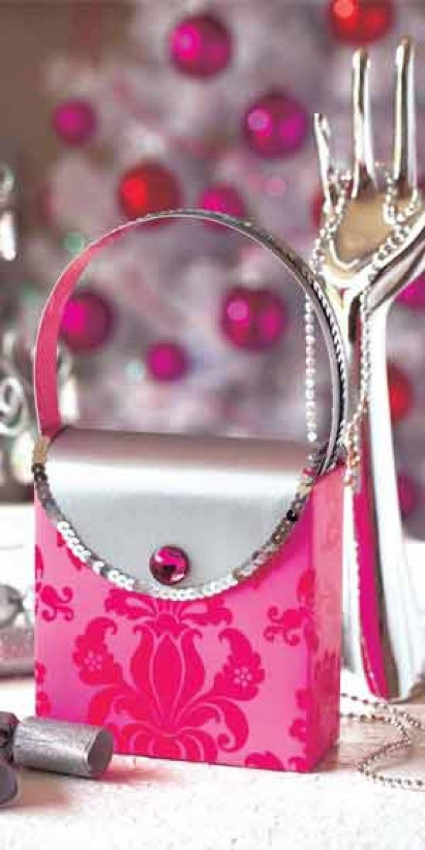 """Girly gift wrapping; see how to make this """"purse"""" gift bag here."""