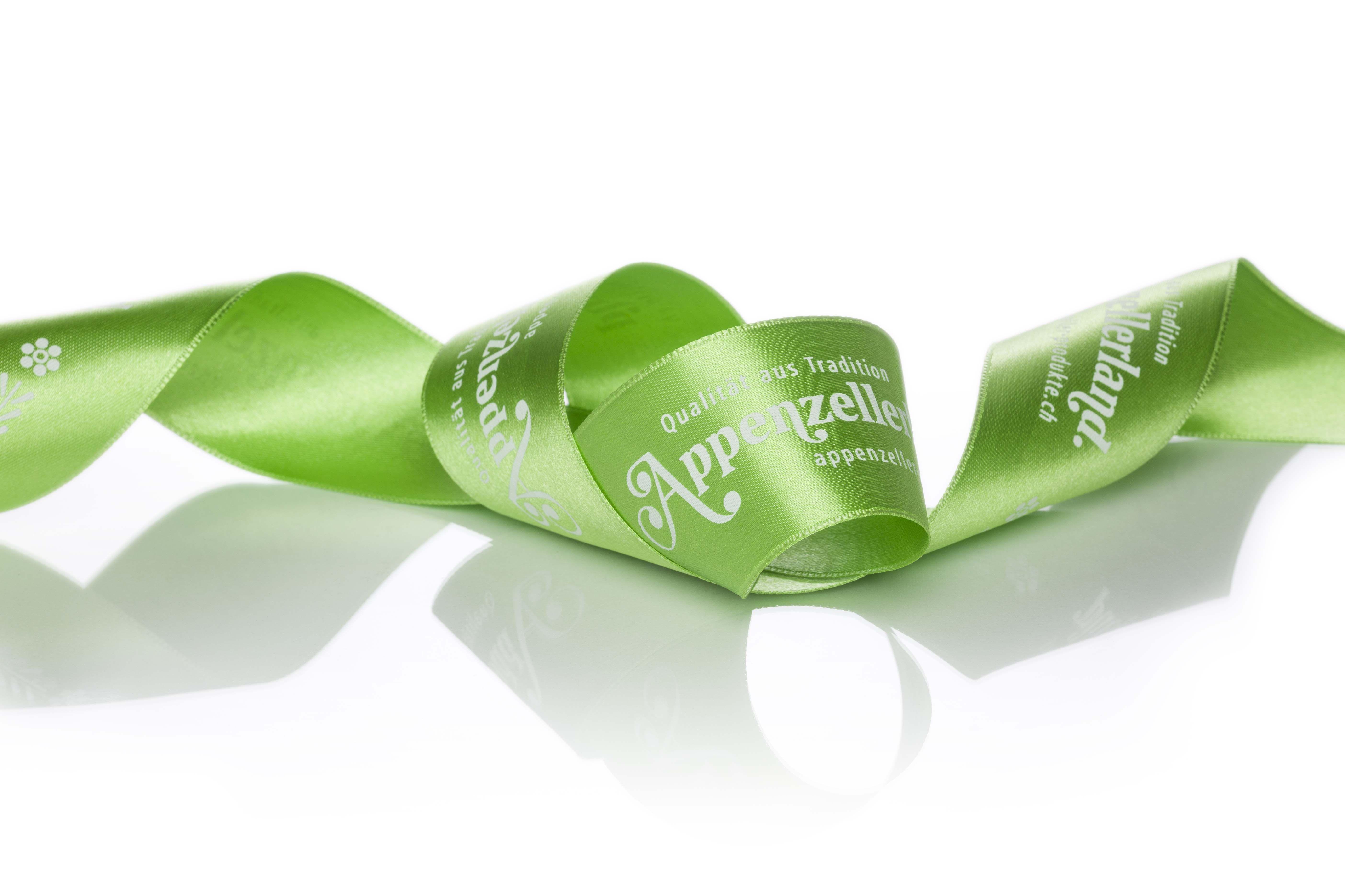 apfelgrünes Geschenkband mit erfrischender Markenbotschaft #appenzellerland #ferien #tourismus #geschenkbänder #botschaft #marketing #imageribbons #createam #freiburg