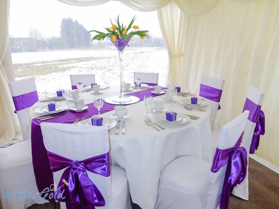Table Decorated For A Purple Wedding