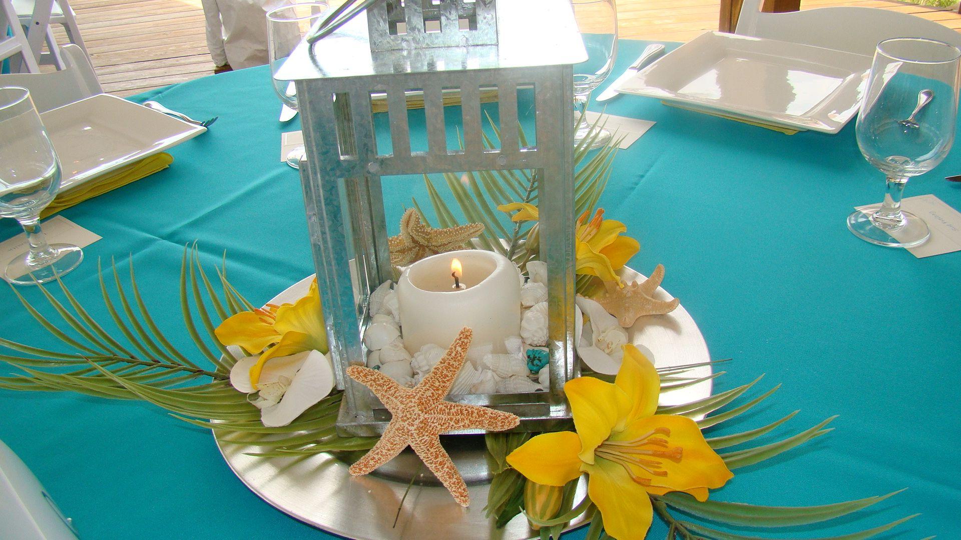 Silver lantern with bright yellow lilies | Beach wedding reception ...