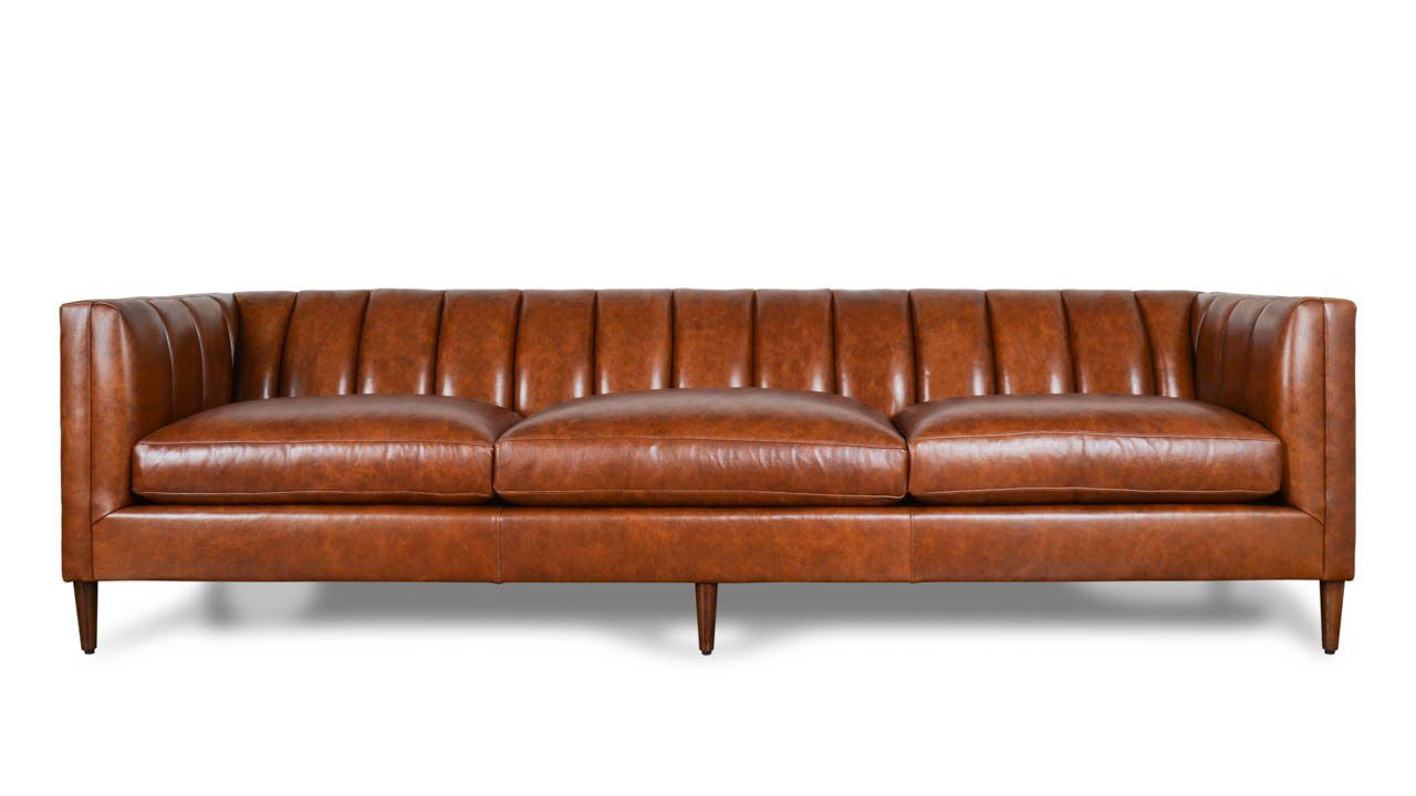 Our clark leather sofa gets its clean sophisticated lines from mid century modern design channel tufting gives this piece a unique sense of style