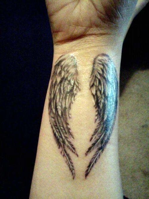 Angel Tattoo On Wrist Wings Tattoos Wrist Tattoos Wing Tattoos