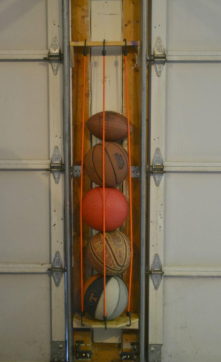 ball pin storage ruggy bungee garage pinterest