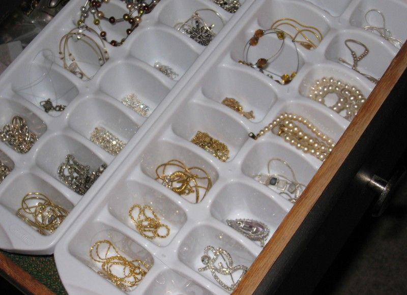 Ice cube trays or egg trays in drawers for jewelry storage Home