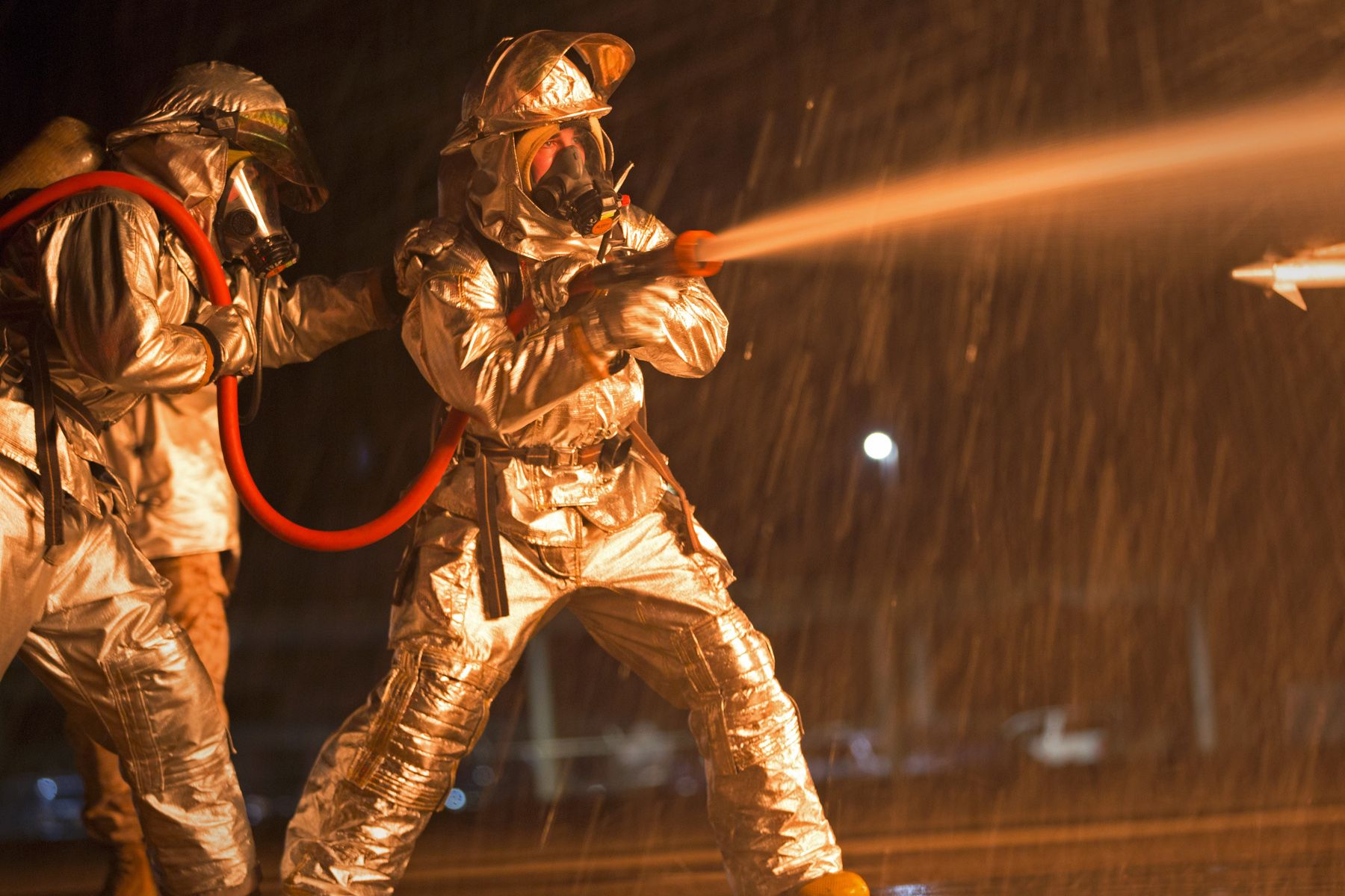 marines extinguish a blaze from a mobile aircraft firefighting training device on marine corps air station kaneohe bay in hawaii oct 30 2014