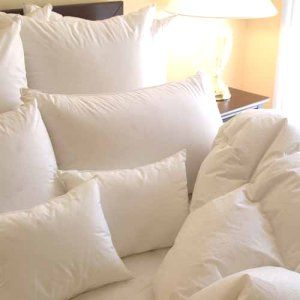 Lots Of Fluffy Pillows And A Down Comforter Have A Hard
