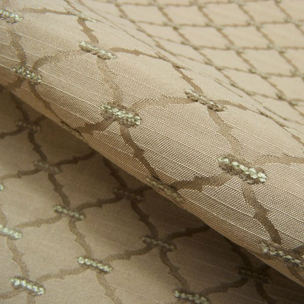 Commerce Tranquil Tissue Pick Lattice Tan Upholstery Fabric - A tissue pick of boucle and chenille yarns form the sage green details across this thickly woven fabric for upholstery. The satin lattice pattern in taupe tan is neutral with a traditional, sophisticated look.