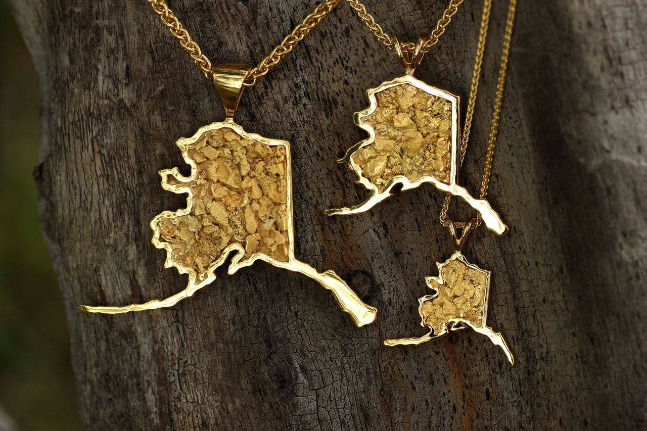 Collection of our alaska state map pendants done in kt yellow