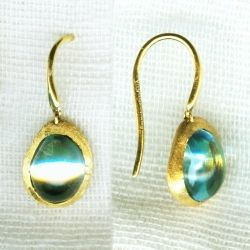Love these cute yellow gold blue topaz earrings! Available at Argo & Lehne Jewelers.