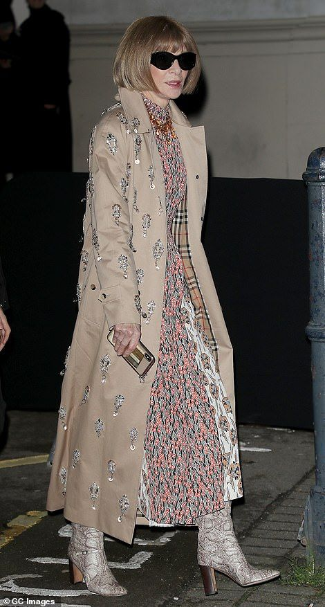 Clashing: Anna Wintour, 70, wore an eclectic mix of prints, with python print boots and a ...