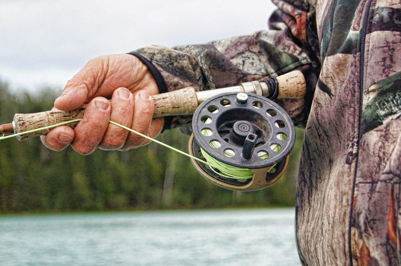 Fisherman fishing reel free photo on pixabay survival
