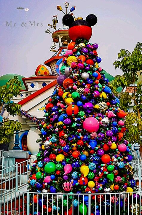 Disney Christmas tree - www.magicalkingdomvacations.com Very colorful! Our tree goes up when Disney puts their tree up.