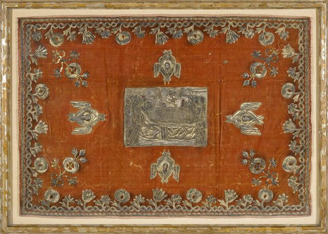 A metallic thread embroidered and applique velvet altar cloth with painted details: The Dormition of the Virgin probably Russian 19th century The central panel depicting Mary on her death bed, surrounded by the twelve Apostles, Christ holding her soul rendered as an infant and flanked by two angels, on a velvet ground further decorated with four Seraphim within an interlace vine and flower border, now within shadow box frame. sight 20 x 29in