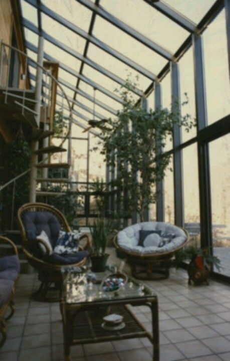 Two story solarium greenhouse with spiral staircase for Two story spiral staircase