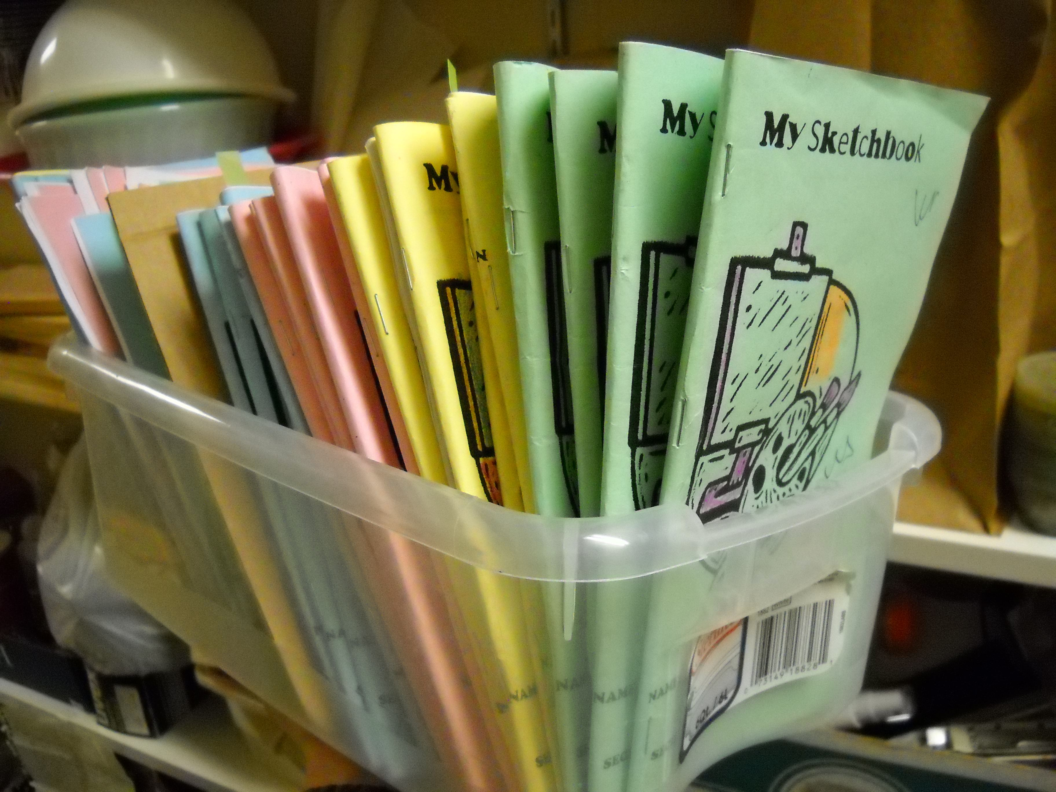 """Sketchbooks for a class.  Class divided by sketchbook color and each """"color"""" has a """"sketchbook leader"""" (which changes each 5-6 wks) who hands out and collects the books.  This has been AMAZING for my art on a cart classes.  I need the first 5 minutes to set up, get my lesson up on the computer, and breathe.  They need something to DO the first 5 minutes and during extra time at the end-- answer: sketchbooks."""