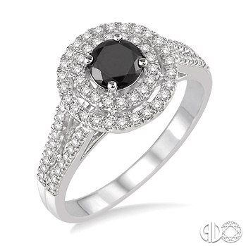 Crafted In Icy Cool 10 Karat White Gold This Ring Features A Centrally Staged Prong Set Round Black Diamond Ring Gemstone Rings Semi Precious Gemstone Jewelry