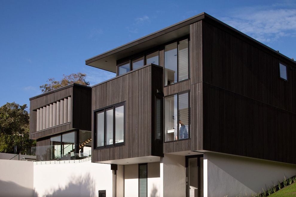 Vertical wood siding exterior modern with cantilevered for Vertical siding on house