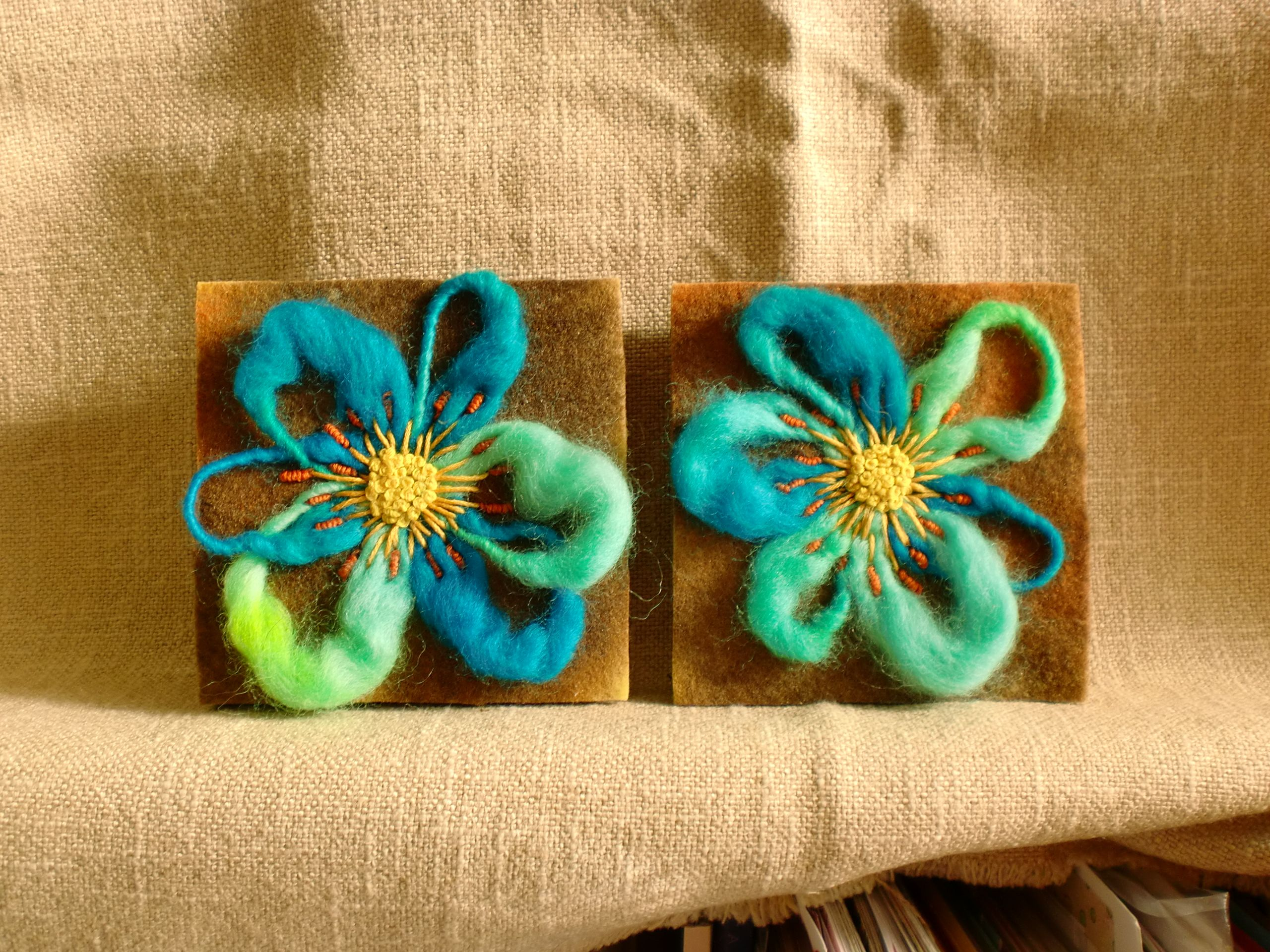 Needle felt with embroidered centres by Sheila Hodson.