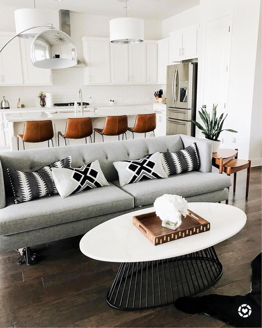 Adding Just A Touch Of Black To A White Themed Room Provides A Focal Point Everyon Black And White Living Room Apartment Living Room Design Living Room Grey