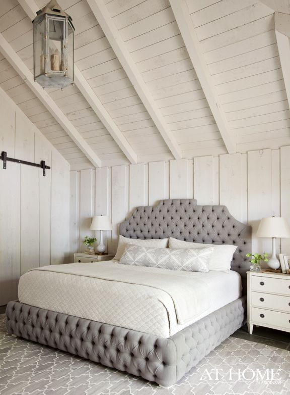 beautiful grey and white bedroom love the tufted bed the hanging lantern and the wood walls and ceiling