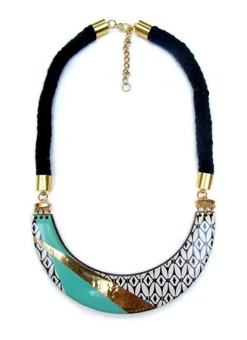 Turquoise and Gold Bib Necklace. This laser cut wood bib necklace with black soft cotton braided rope is based on a series of black and white monochrome patterns with turquoise and gold colour block geometric stripes. Bold and stylish, the necklace is finished with a glossy domed layer of resin to add depth and protection.  £55 #necklace #jewellery #gift #ideas #unique