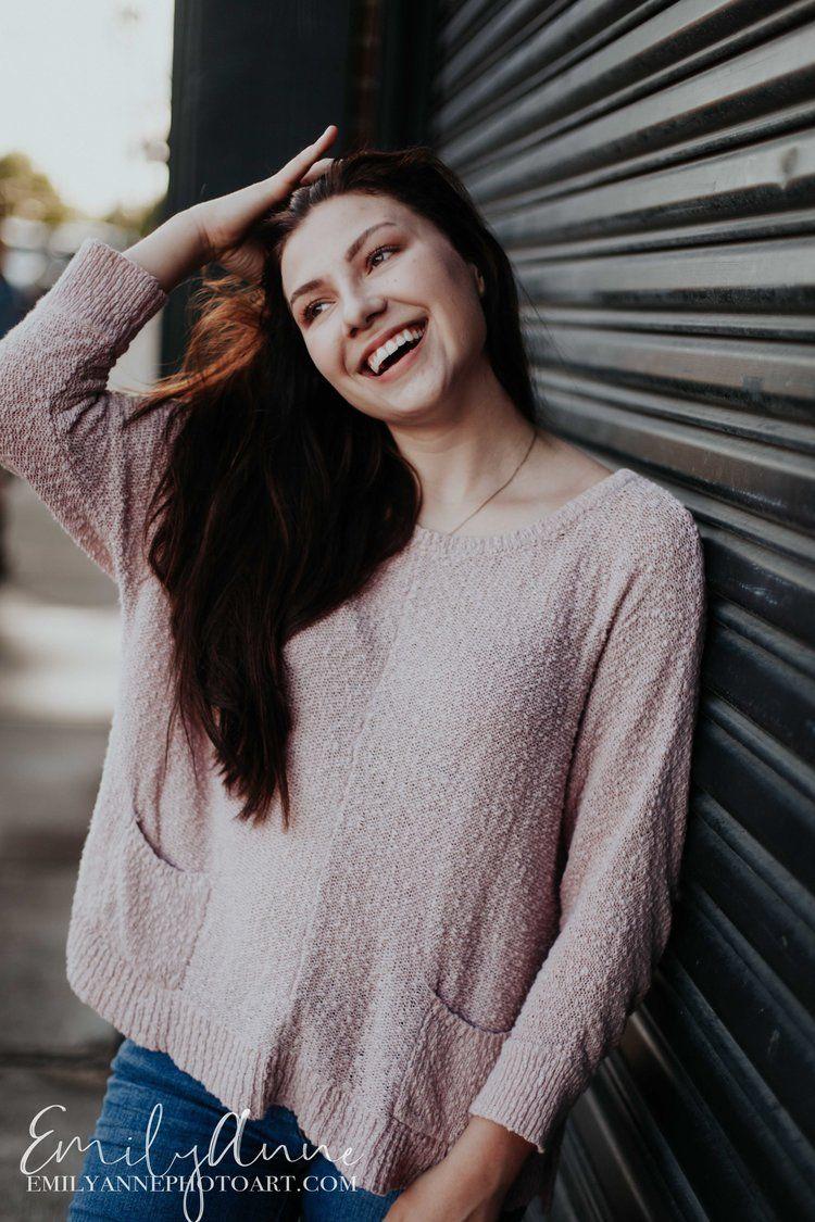 fun senior portrait photos nashville tn; candid girl laughing pic; senior  portraits for a girl in the city urban retro look