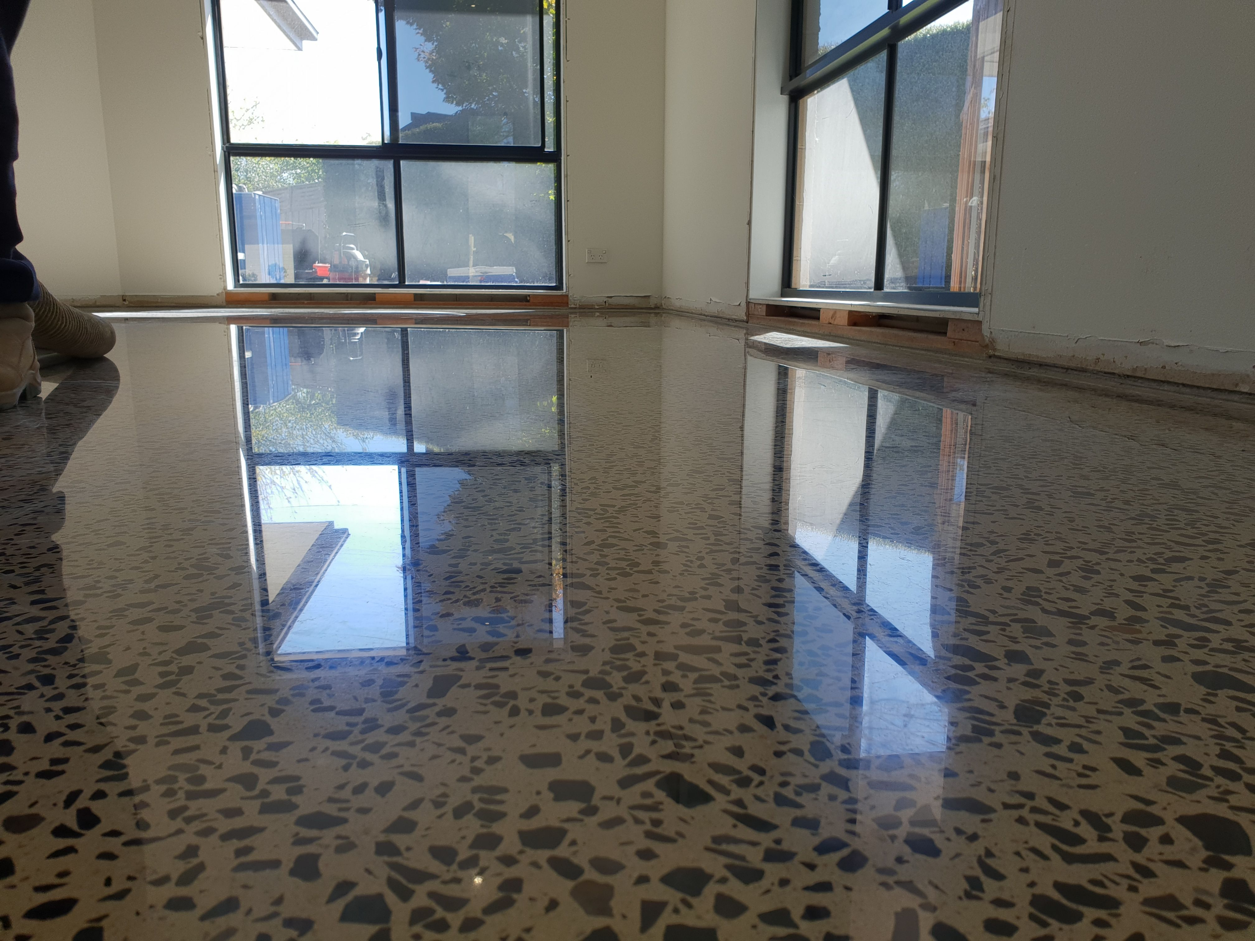 Polished Concrete in Gloss Finish with full stone exposure