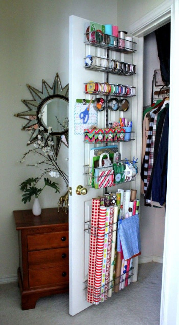 You can keep your entire collection in one place (and make use of often a wasted storage possibility) by hanging baskets onto the back of your closet door for ribbon, paper, and bags.