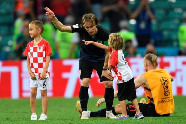 Croatia's midfielder Luka Modric gestures next to his son Ivano after winning the Russia 2018 World Cup quarterfinal football match between Russia...