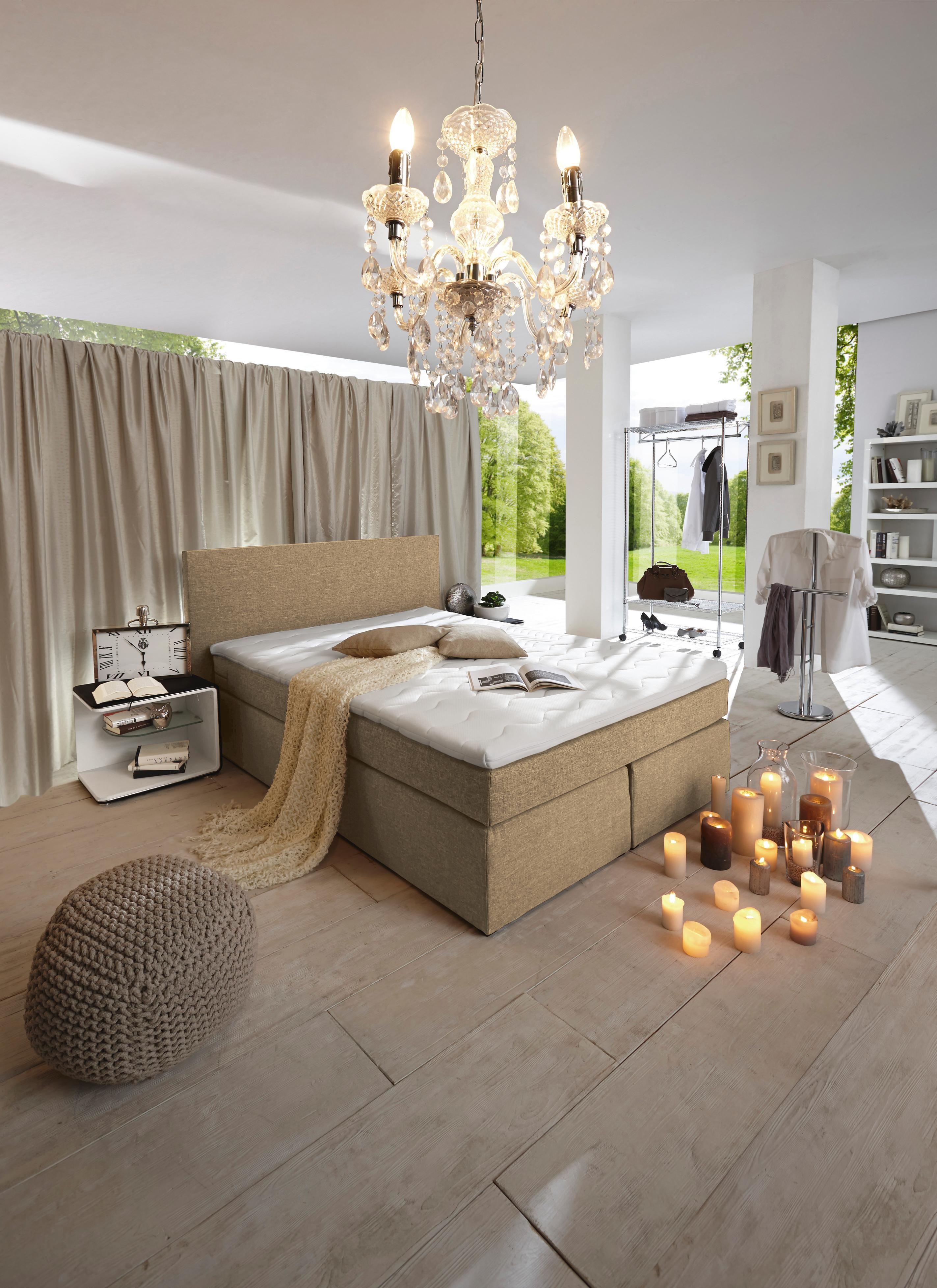 Wenn Träume wahr werden: Dieses elegante Boxspringbett ist nicht nur ein Hingucker in jedem Schlafzimmer, sondern überzeugt auch durch seine bequeme Polsterung und Liegefläche. Ein Bett für erholsamen Schlaf!