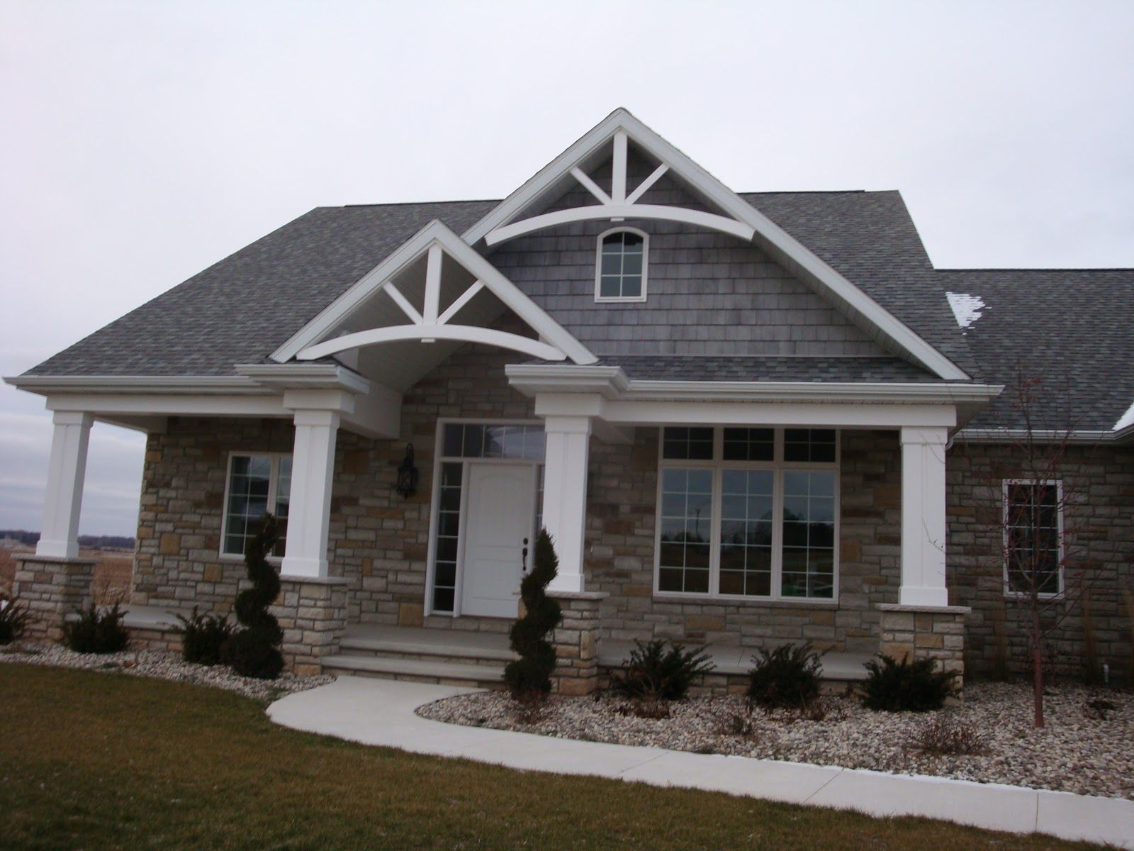 Vinyl siding and stone combination stucco option a nice for Stucco stone exterior designs