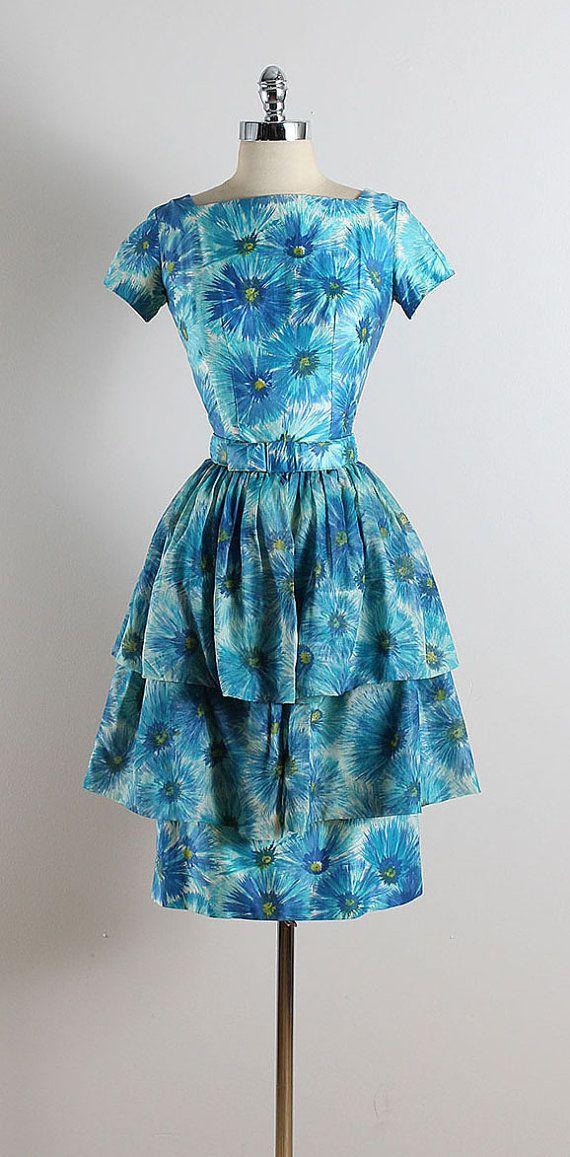 ➳ vintage 1950s dress  * blue floral cotton * detachable belt * optional layered skirt * bow belt accent * metal back zipper  condition | excellent fits like xs/s  length 41.5 bodice 16 bust 36 waist 25 hips 37 skirt length 19.5 skirt waist 15  ➳ shop http://www.etsy.com/shop/millstreetvintage?ref=si_shop  ➳ shop policies http://www.etsy.com/shop/millstreetvintage/policy  twitter | MillStVintage facebook | millstreetvintage instagram | millstreetvintage  5761/1622