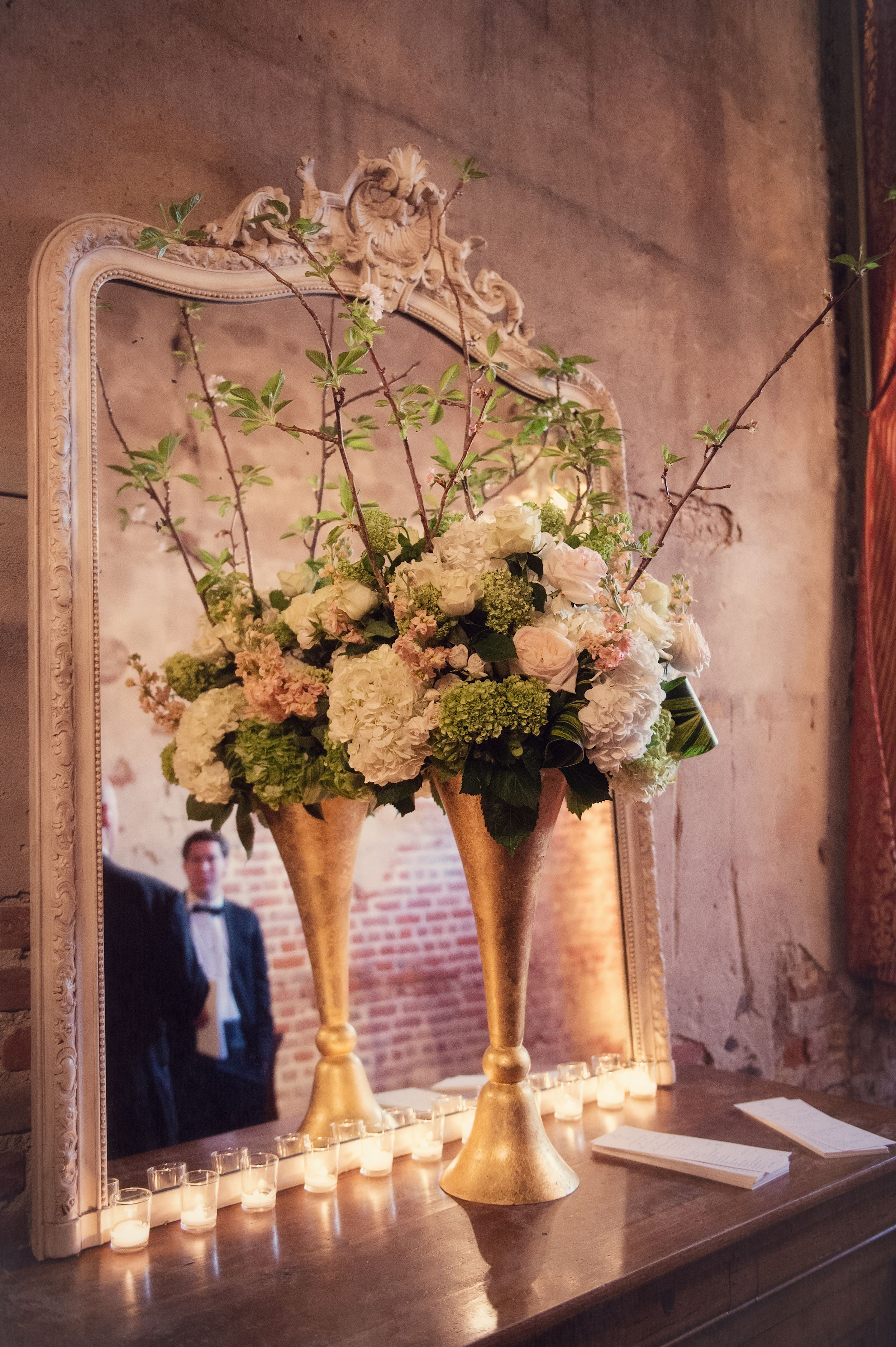 Gold trumpet vase with cherry branches, white hydrangeas, blush ...