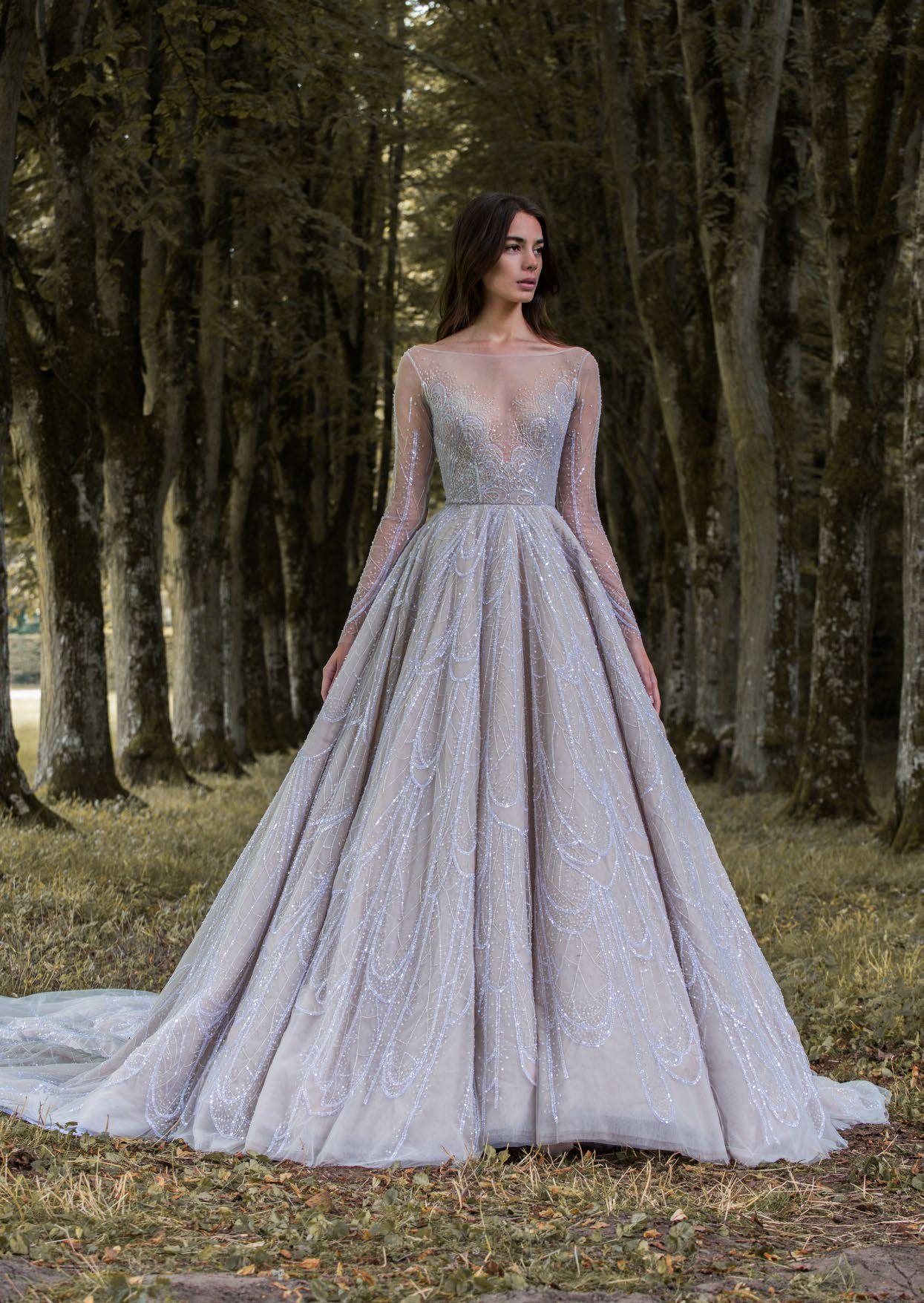 Dusky lavender gossamer wing-inspired long sleeved wedding ball gown ...