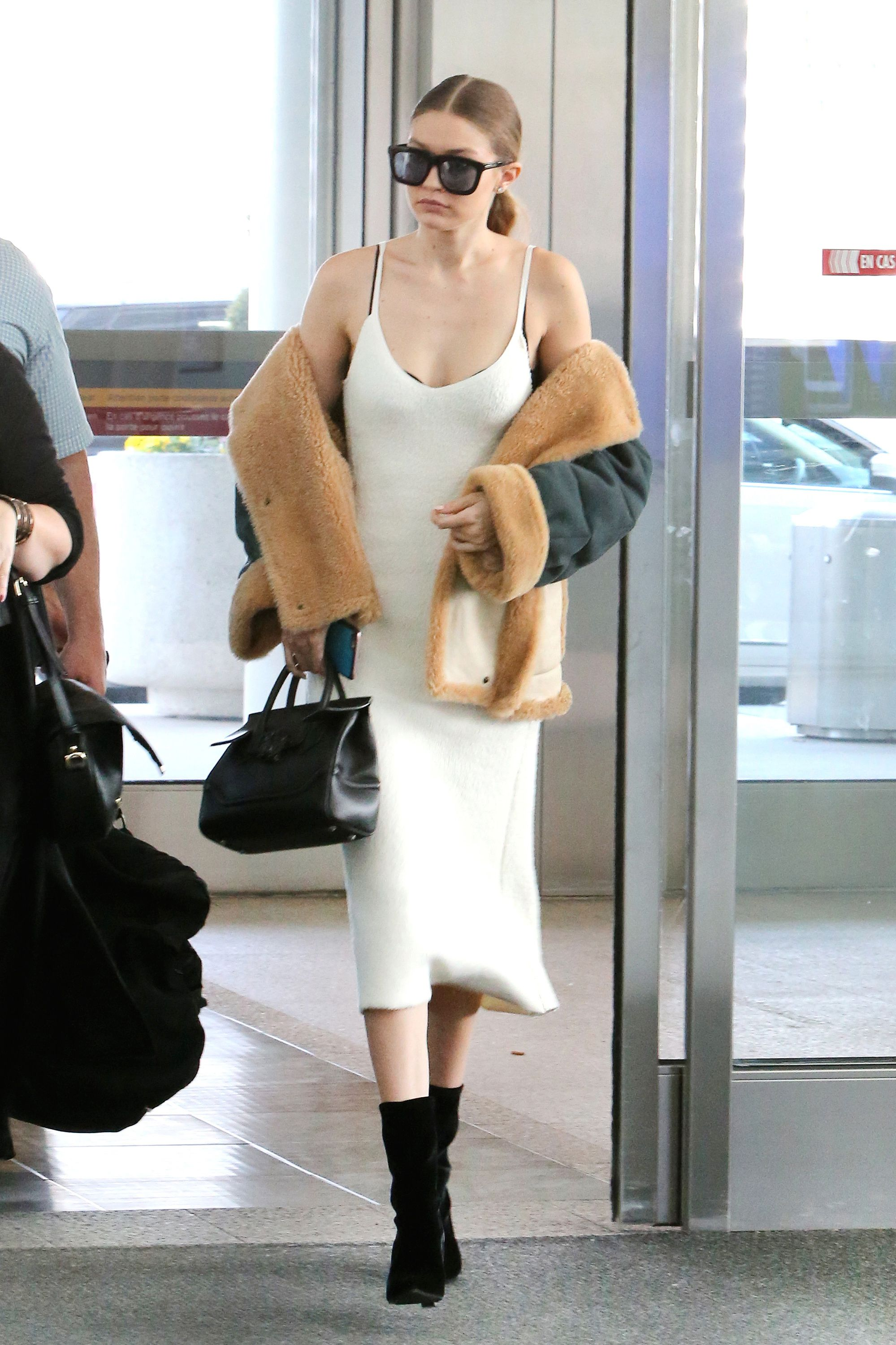 Gigi Hadid Staves Off Airport Chill in the Summer Shearling